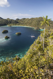Forest-Covered Limestone Islands Surround a Lagoon in Raja Ampat Photographic Print by  Stocktrek Images
