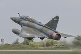 A French Air Force Mirage 2000D Taking Off Photographic Print by  Stocktrek Images