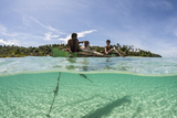 Young Villagers Fish Off their Outrigger Near a Remote Island in Indonesia Photographic Print by  Stocktrek Images