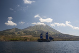 An Indonesian Pinisi Schooner Sails Near a Remote Volcanic Island Photographic Print by  Stocktrek Images