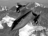 A Sr-71B Blackbird Flying across the Sierra Nevada Mountains Photographic Print by  Stocktrek Images