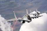Bulgarian and Polish Air Force Mig-29S Planes Flying over Bulgaria Photographic Print by  Stocktrek Images