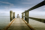 Germany, Schleswig-Holstein, Wyk, Beach, Woman, Bridge, Sitting, Back View Photographic Print by Ingo Boelter