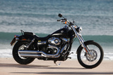 Motorcycle, Cruiser, Harley Davidson Wide Glide, Black, Sea in the Background, Side Standard Right Photographic Print by  Fact