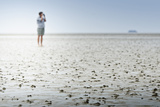 Germany, Schleswig-Holstein, Pellworm, Mud Flats, Woman Photographic Print by Ingo Boelter
