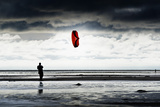 Germany, Schleswig-Holstein, Amrum, Sandy Beach, Sandbank, Kniepsand, Person Flying Kite Photographic Print by Ingo Boelter