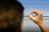 Germany, Schleswig-Holstein, Pellworm, Mud Flats, Wadden Sea, Lighthouse, Woman, Hand, Finger, View Photographic Print by Ingo Boelter