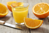 Sliced Oranges and Glass with Fresh Orange Juice Photographic Print by Jana Ihle