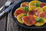 Orange Salad and Blood Orange Salad on Dark Plate Photographic Print by Jana Ihle