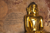Golden Buddha Statue in Front of Burmese Writing on Wall, Bagan, Myanmar Photographic Print by Harry Marx