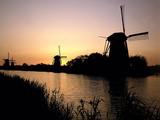 Netherlands, Kinderdijk, Canal, Windmills, Evening Mood Photographic Print by  Thonig