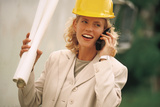 Woman in Hard Hat with Blueprints Talking on Cell Phone Photographic Print by  Comstock