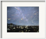 Artwork of Meteor Shower Over a City Poster by Chris Butler