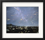 Artwork of Meteor Shower Over a City Prints by Chris Butler