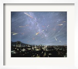 Artwork of Meteor Shower Over a City Posters by Chris Butler