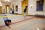 Jimmy Fallon and First Lady Michelle Obama Have a Potato Sack Race in the East Room Photo