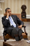 President Barack Obama Listens During to Advisors in the Oval Office Photo