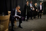 President Barack Obama Reviews Notes as His Staff Waits before an Event in Denver, Colorado Photo