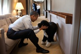 President Barack Obama Plays with Bo, Aboard Air Force One During a Flight to Hawaii Photo