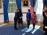 President Barack Obama and Michelle Obama Embrace after the Official Swearing-In Ceremony Photo