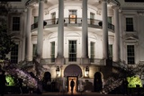 President Barack Obama Enters the South Portico of the White House at Night on March 30, 2012 Photo