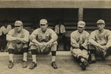 Boston Red Sox Players Sitting in Front of their Dugout Photo