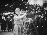 First Lady Florence Harding Cranks a Newsreel Camera before a Group of Women Journalists Photo