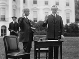 President Calvin Coolidge Taking an Oath before Filling Out His Ballot for the 1924 Election Photo
