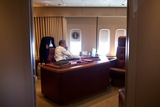 President Barack Obama Holds a Conference Call with Advisors from His Office Aboard Air Force One Photo