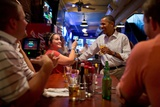 President Barack Obama Has a Beer with Patrons at the Pump Haus Pub and Grill in Waterloo, Iowa Photo