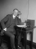Herbert Hoover, Secretary of Commerce, Listening to a Radio on Dec. 31, 1924 Photo