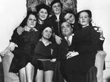 FBI Director J. Edgar Hoover on a Loveseat with Six Women at the Willard Hotel, Washington, D.C. Photo