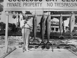 Warren Harding with Fishing Rod and Fish at Cocolobo Cay Club, Adams Key, Florida. Ca. 1921-23 Photo