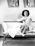 Kay Francis, Modeling White Crepe Lounging Pajamas with a Paisley Sash, Ca. Mid-1930s Photo