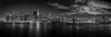 Illuminated Skylines at the Waterfront, Manhattan, New York City, New York State, USA Fotografisk tryk af Panoramic Images,