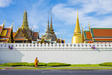 A Monk Passes in Front of Wat Phra Kaew and the Grand Palace, Bangkok, Thailand Photographic Print by Jason Langley