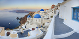 White Houses and Blue Domes of the Churches Dominate the Aegean Sea, Oia, Santorini Photographic Print by Roberto Moiola