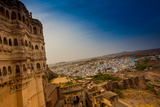 The View from the Main Courtyard of Mehrangarh Fort Towering over the Blue Rooftops in Jodhpur Photographic Print by Laura Grier