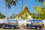 Colorful Tuk-Tuks in Front of Haw Pha Bang Temple on Grounds of Royal Palace Museum, Luang Prabang Photographic Print by Jason Langley