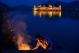 Boy Cooking at Twilight by the Jal Mahal Floating Lake Palace, Jaipur, Rajasthan, India, Asia Photographic Print by Laura Grier