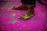 Man's Bare Feet During the Color Pigment Throwing Festival, Holi Festival, Vrindavan Photographic Print by Laura Grier