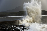 Huge Waves Crash Against a Stone Jetty at Criccieth, Gwynedd, Wales, United Kingdom, Europe Photographic Print by Graham Lawrence