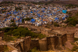 The Palace Walls of Mehrangarh Fort Towering over the Blue Rooftops in Jodhpur, the Blue City Photographic Print by Laura Grier