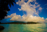 Rainbow Arcing over the Overwater Bungalows, Le Taha'A Resort, Tahiti Photographic Print by Laura Grier