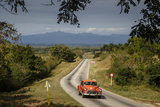 Old Vintage American Car on a Road Outside Trinidad, Sancti Spiritus Province, Cuba Photographic Print by Yadid Levy