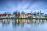 Clouds on the Typical Houses and Towers of Cathedral Reflected in River Trave at Dusk, Lubeck Photographic Print by Roberto Moiola