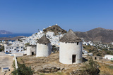 A Typical Greek Village Perched on a Rock with White and Blue Houses and Quaint Windmills, Ios Photographic Print by Roberto Moiola