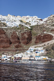 Typical Greek Village Perched on Volcanic Rock with White and Blue Houses and Windmills, Santorini Photographic Print by Roberto Moiola