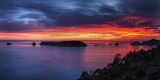 A Fiery Dawn Sky Breaks Beyond the Islands Off the Coromandel Peninsula, Waikato, North Island Photographic Print by Garry Ridsdale