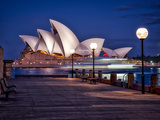 A Boat Passes by the Sydney Opera House, UNESCO World Heritage Site, During Blue Hour Photographic Print by Jim Nix
